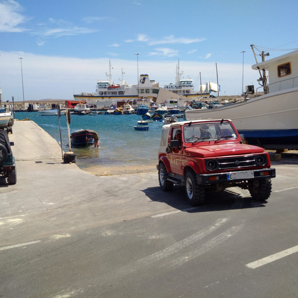 Jeep and boat at Mgarr Harbour